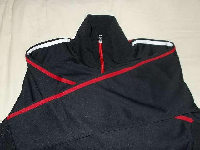 UnitedAthle ユナイテッドアスレ 7.0オンス ジャージ ラグランスリーブ ジャケット 1995-01 9830 ブラック/レッド/ホワイト Mサイズ 黒地をメインに肩から手首にかけて 2本の赤・白ライン、ファスナーはすべて赤色のデザイン
