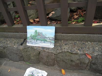 9  おじさんが道端で絵を描いていた