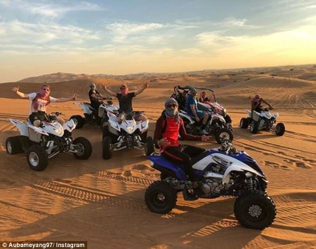 Aubameyang posted this picture of he and pals quad biking in the Dubai desert