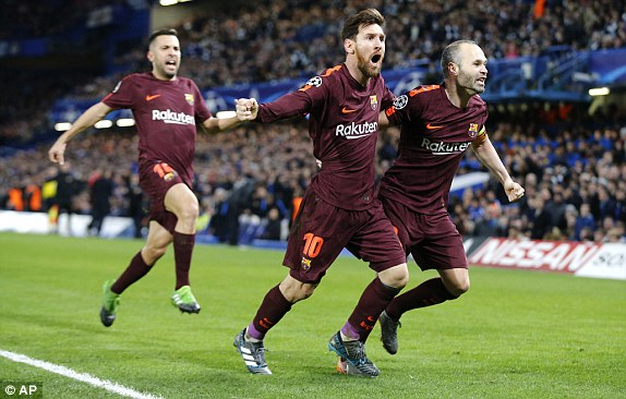 Messi celebrates grabbing the equaliser along with Andres Iniesta goal against chelsea